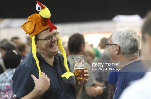 A man wearing a hat holds a glass of beer at the Great British Beer Festival held at Earls Court LondonPicture date Tuesday August 3 2010 As the real...