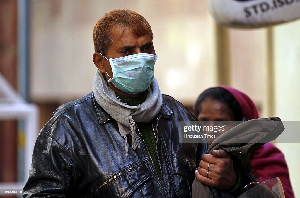 A man wearing a mask as a precaution measure against swine flu virus, at a RML hospital on February 8, 2013 in New Delhi, India. According to local reports, 64 cases have been reported so far out which three persons infected with swine flu have died.