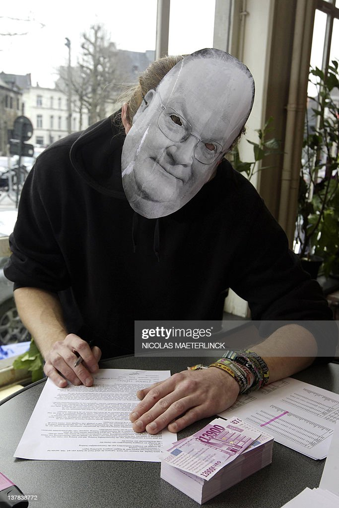 A man wearing a mask of Dexia chairman <a gi-track='captionPersonalityLinkClicked' href=/galleries/search?phrase=Jean-Luc+Dehaene&family=editorial&specificpeople=2586798 ng-click='$event.stopPropagation()'>Jean-Luc Dehaene</a>m, files a complaint, on the first public complaint day against the Dexia bank and the Holding Communal on January 28, 2012. The Holding Communal which was the main shareholder of the former Dexia bank Group accepted in October 2011 the proposal of voluntary liquidation. The Holding Communal is a Belgian Holding founded in 1996 by the districts and provinces of Belgium which were shareholders.