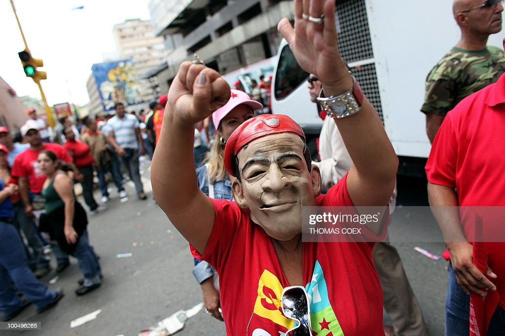 A man wearing a mask of Venezuelan President Hugo Chavez takes part in a demonstration in favour of a new education law, near the Parliament House in downtown Caracas on August 13, 2009 while the lawmakers discuss the bill.