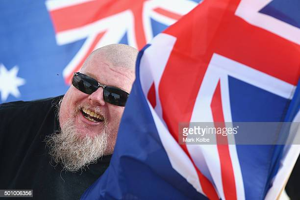 A man wearing a no Sharia law shirt is pictured as he is interviewed by a television crew at Wanda beach Cronulla on December 12 2015 in Sydney...