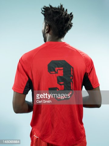 A man wearing a numbered soccer shirt