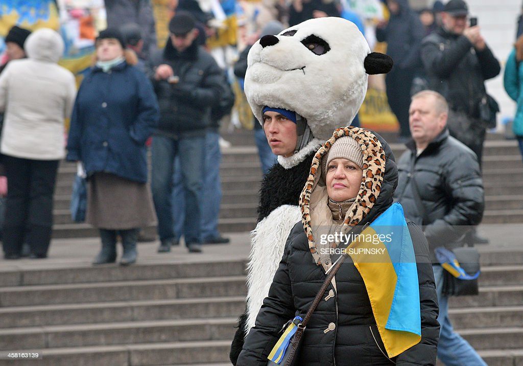A man wearing a panda suit stands near a tent camp on the Independence Square during a non-stop protest of the Ukrainian opposition on December 20, 2013. EU chair Lithuania hit out Friday at Kiev, saying the European Union remained open to signing a partnership accord with Ukraine but 'not necessarily' with Viktor Yanukovych's government. 'Europe is open for Ukrainian people but not necessarily to this government,' said Lithuanian leader Dalia Grybauskaite, who holds the rotating presidency of the European Union.