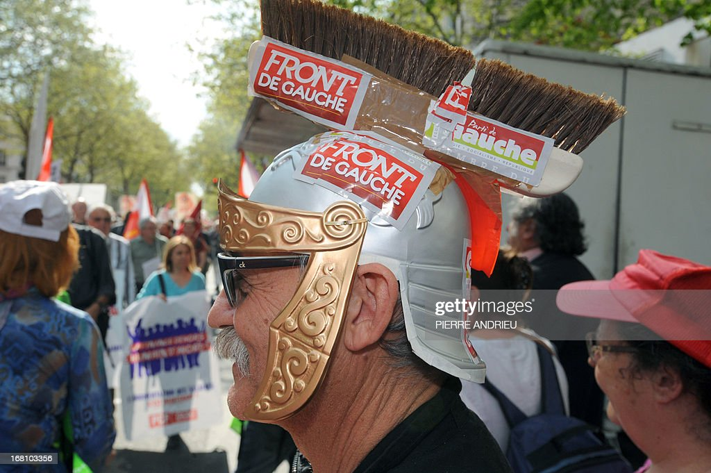 A man wearing a Roman helmet made with a broom takes part in a demonstration on May 5, 2013 in Paris, called by Jean-Luc Melenchon, leader of Front de Gauche (Left Front) left wing party, to protest 'against the austerity, against the finance and to ask for a Sixth Republic'. When France's president Francois Hollande swept to power on May 2012 on a wave of discontent, he could hardly have imagined that a year later he would be the most unpopular president in modern French history. The broom refers to Melenchon's call for May 5 protest as a 'sweeping out'.