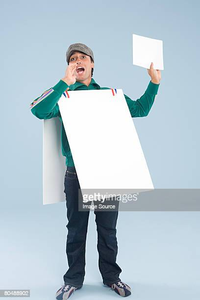 A man wearing a sandwich board