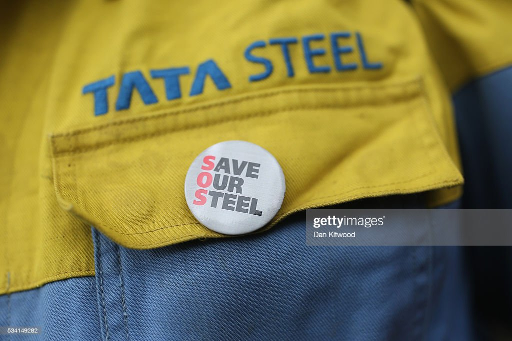 A man wearing a 'Save Our Steel' badge is seen as steel workers prepare to march towards the Houses of Parliament on May 25, 2016 in London, England. Steelworkers marched through Westminster today to highlight the crisis in the steel industy. A shortlist of bidders is currently being drawn up for the UK assets of Tata Steel.