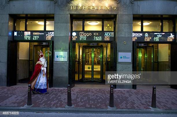 A man wearing a Sinterklaas costume arrives at the Amsterdam Stock Exchange where he will beat the gong on behalf of the foundation Stichting...