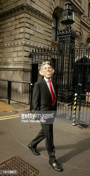 A man wearing a Tony Blair mask walks past the front gates of Downing Street on May 10 2007 in London England Prime Minister Blair will travel to his...