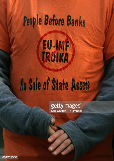 A man wearing a tshirt stands outside a press conference in Dublin on the progress of Irelands Fourth Quarter 2011 debt repayment at Government Press...