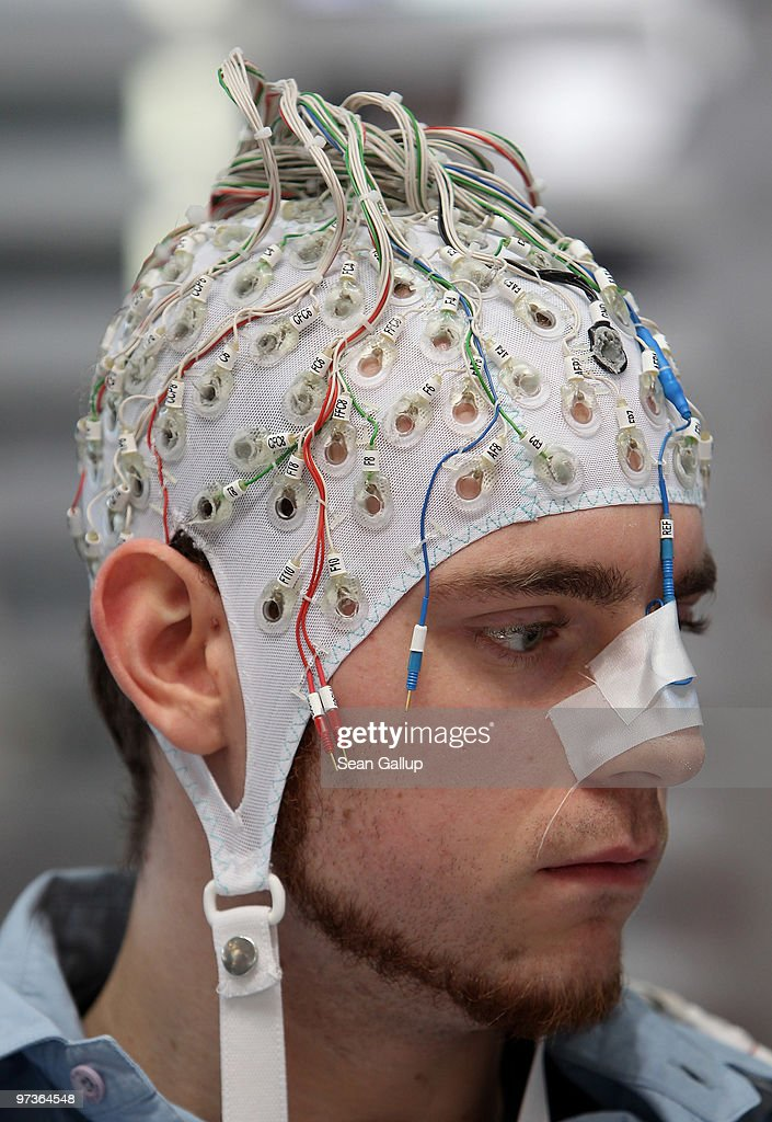 A man, wearing an EEG brain scanning apparatus on his head, plays a pinball game solely through willing the paddles to react with his brain at the Berlin Brain Computer Interface research consortium stand at the CeBIT Technology Fair on March 2, 2010 in Hannover, Germany. CeBIT will be open to the public from March 2 through March 6.