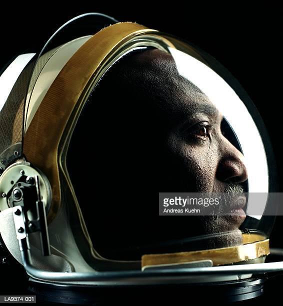 Man wearing astronaut helmet, profile, close-up