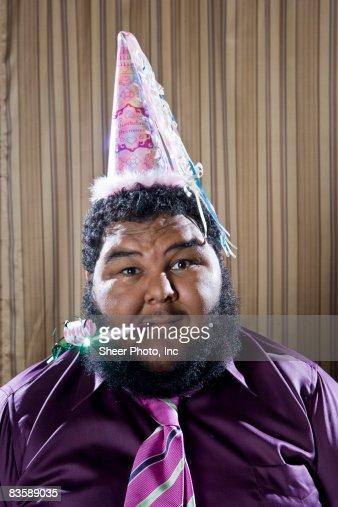 Man wearing birthday princess hat  : Stock Photo