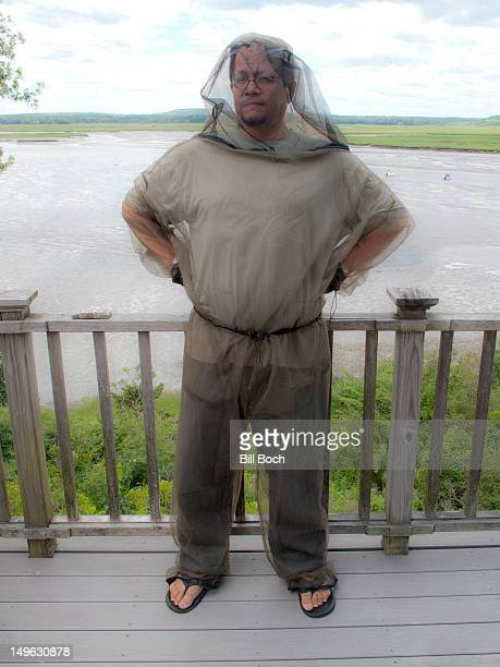 Man wearing biting insect protective clothing