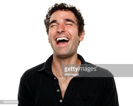 Man wearing black shirt laughing with eyes shut