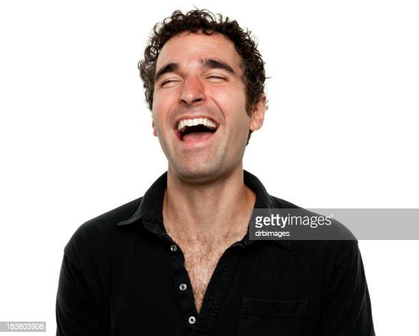 Man wearing black shirt laughing with eyes shut