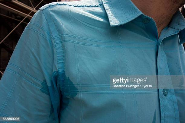 Man Wearing Blue Shirt And Sweating Armpit