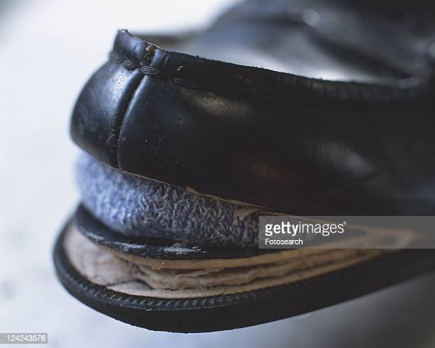 Man wearing broken shoe