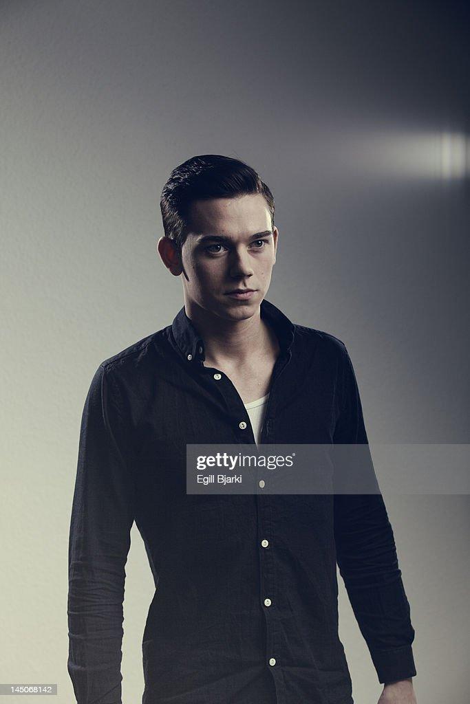 Man wearing button-up shirt indoors : Stock Photo