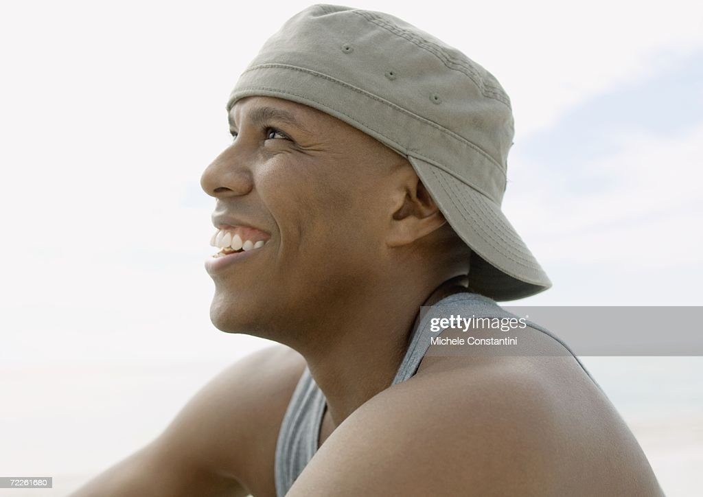 Man wearing cap backwards, laughing