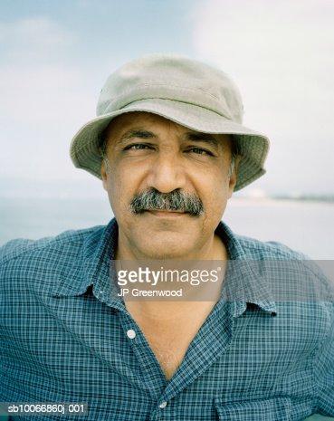 Man wearing cap, close-up, portrait : Stock Photo