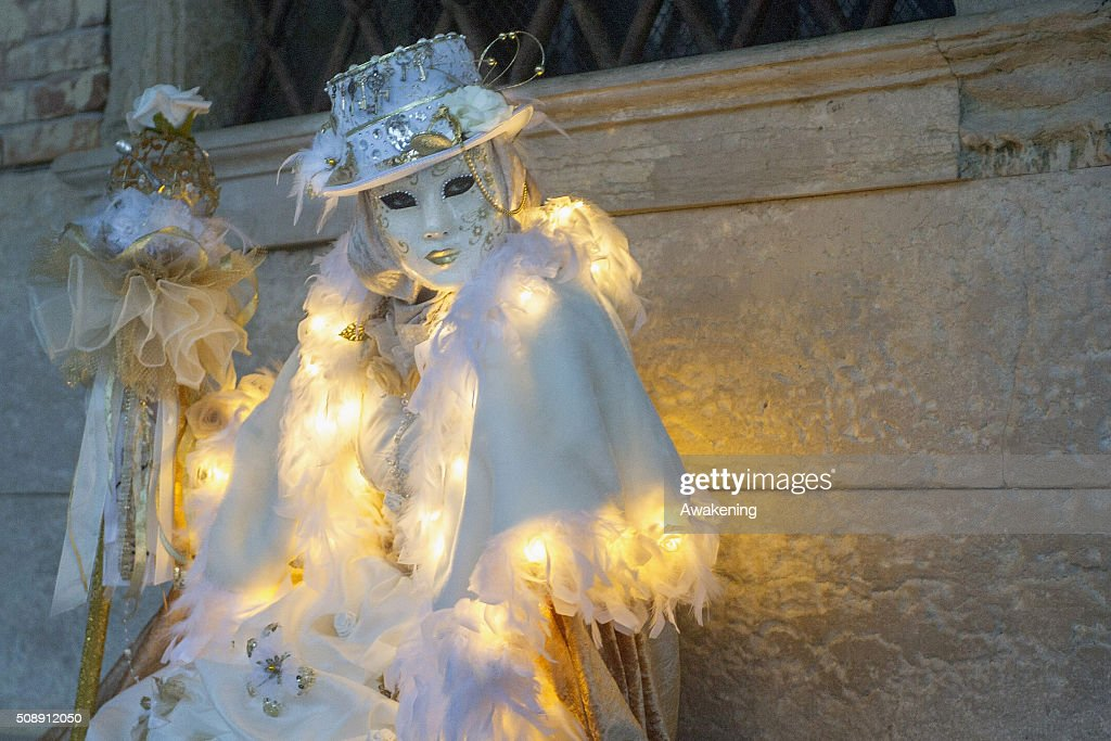 A man wearing carnival costume poses in Piazza San Marco during the 2016 Venice Carnival on February 7, 2016 in Venice, Italy. The 2016 Carnival of Venice will run until February 9 and includes a program of gala dinners, parades, dances, masked balls and music events.