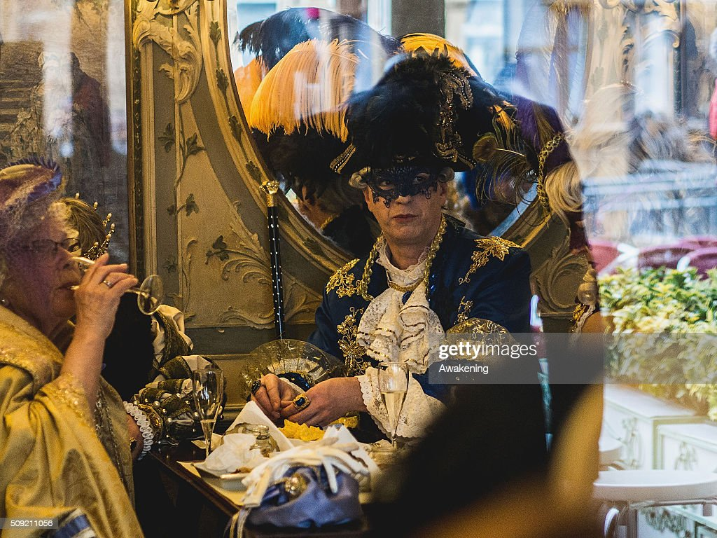 A man wearing carnival costume rests in a bar in Piazza San Marco during the 2016 Venice Carnival on February 9, 2016 in Venice, Italy. The 2016 Carnival of Venice will run until February 9 and includes a program of gala dinners, parades, dances, masked balls and music events.