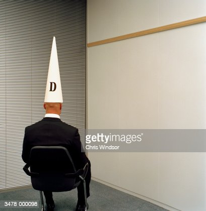 Man Wearing Dunce Hat