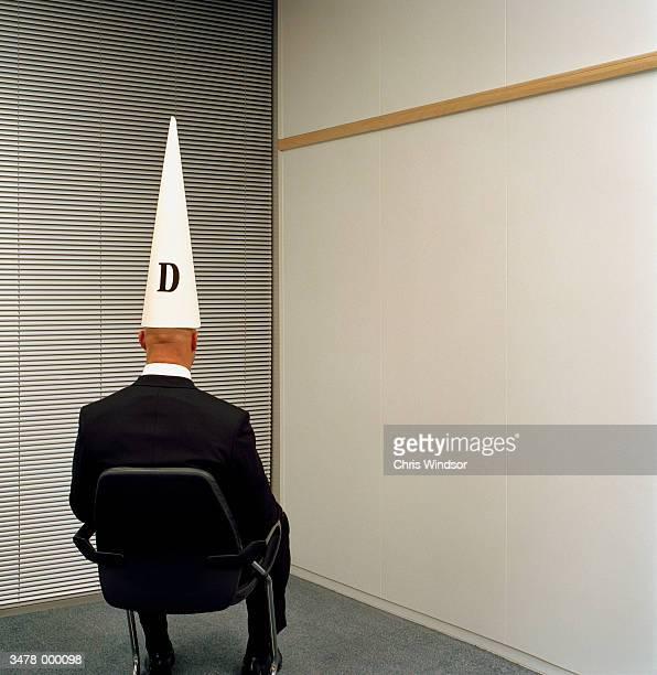 Man Wearing Dunce Hat