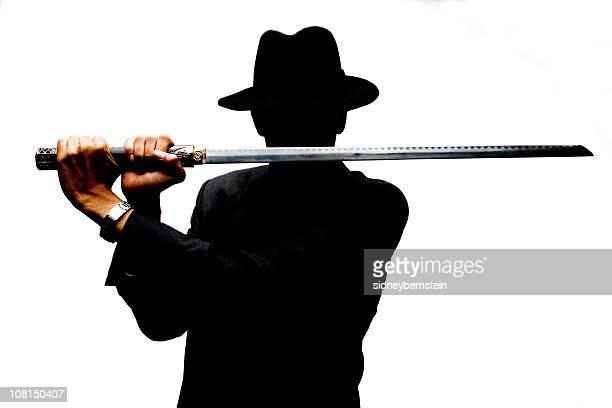 Homme portant Chapeau en feutre et porter Ninja épée sur fond blanc