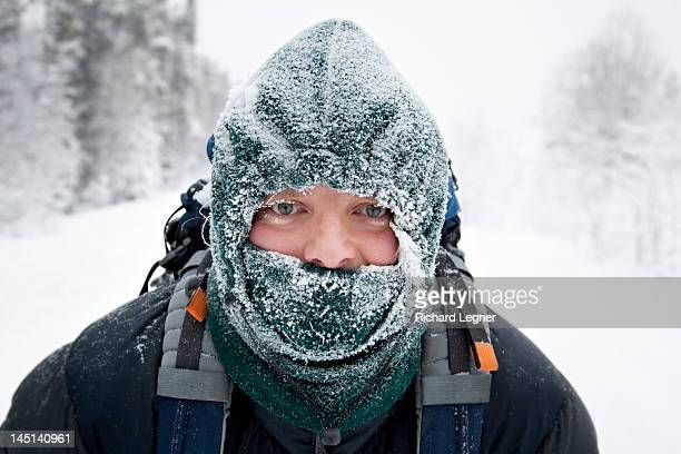 Man wearing frosty face mask