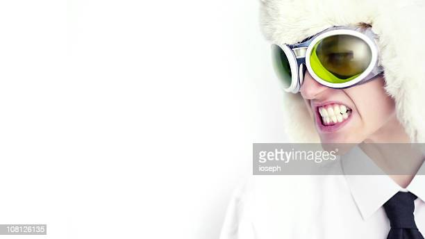 Man Wearing Fur Hat and Green Goggles