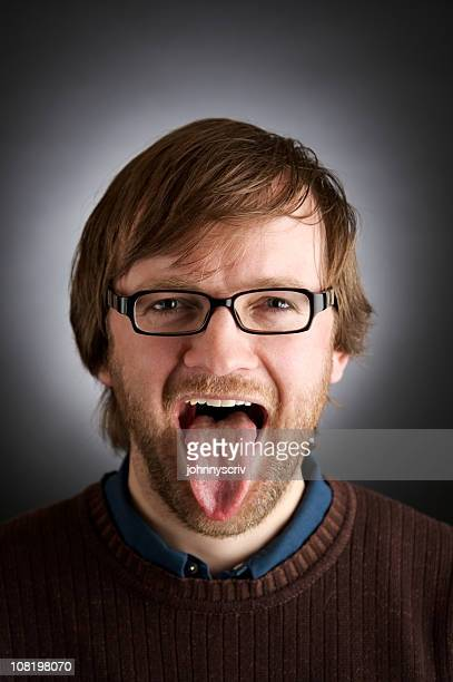 Man Wearing Glasses and Sticking Tongue Out