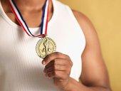 Man wearing gold medal