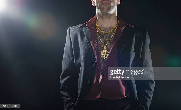 Man Wearing Gold Necklace