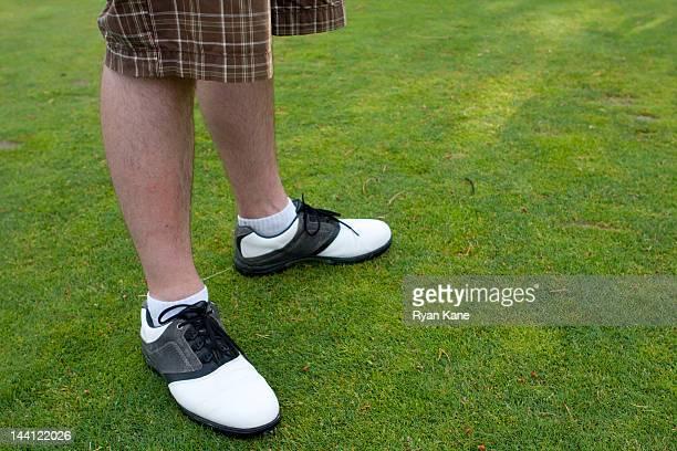 Man wearing golf shoe