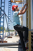 Man wearing hard hat, safety goggles