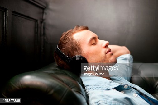 Man wearing headphones listening to music : Stock Photo