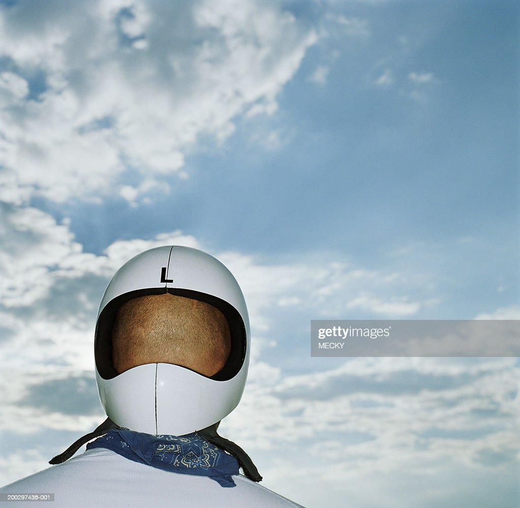 Man wearing helmet back to front, rear view, close-up : Stock Photo