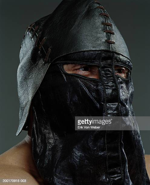 Man wearing leather helmet and mask, close-up