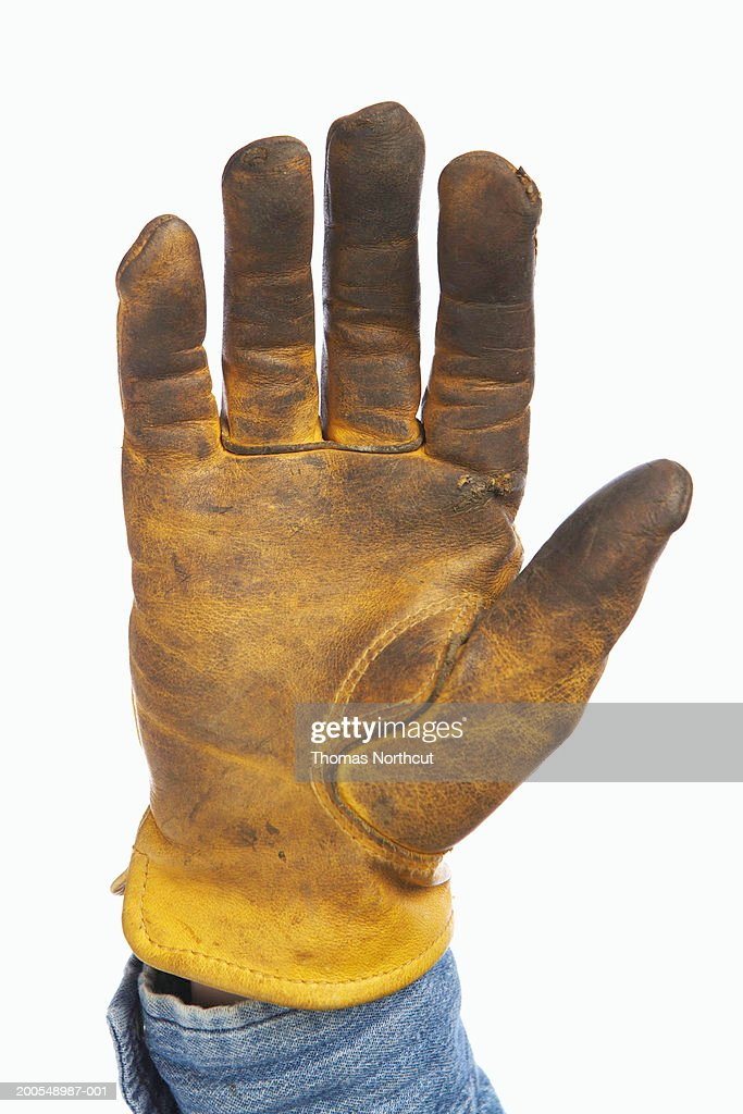 Man wearing leather work glove, close-up of hand : Stock Photo