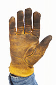 Man wearing leather work glove, close-up of hand
