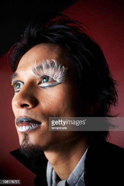 Man Wearing Make-up and Feather Eyelashes