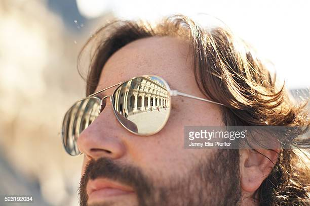 Man wearing mirrored aviators