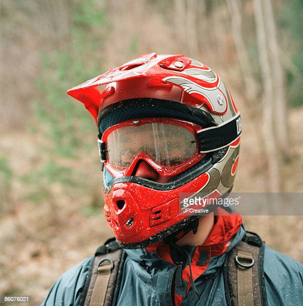 Man wearing motorcycle helmet and goggles