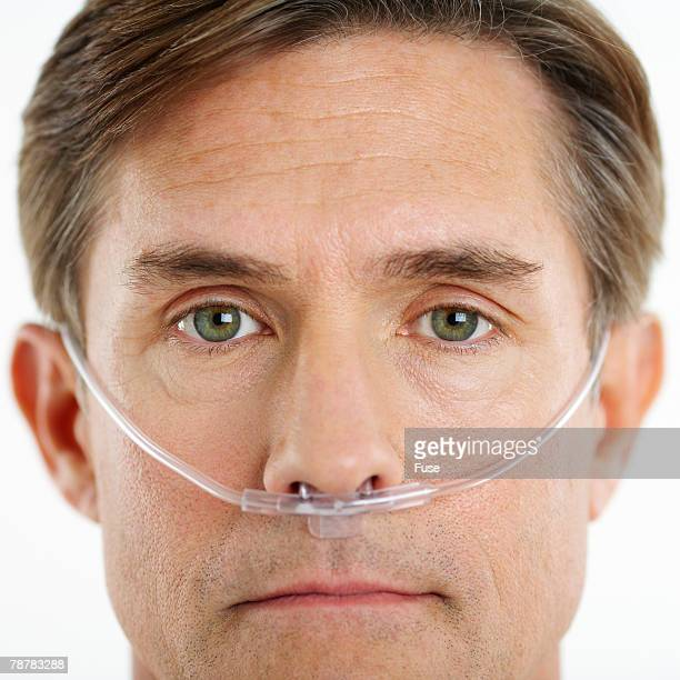 Man Wearing Nasal Cannula for Supplemental Oxygen