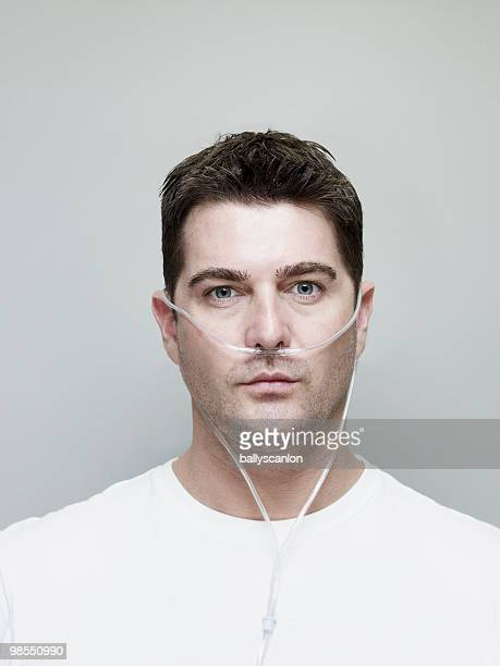 Man Wearing Nasal Oxygen Tube.