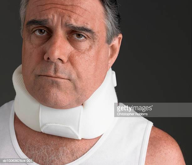 Man wearing neck brace, portrait, close-up