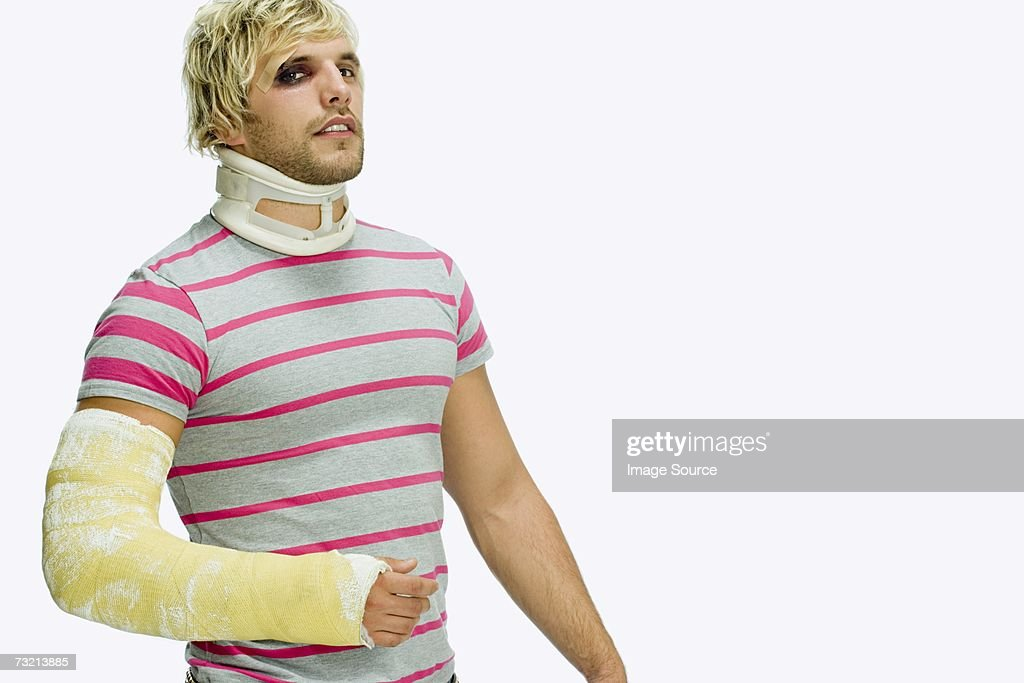 Man wearing neck collar and plaster cast : Stock Photo