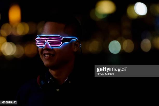 A man wearing novelty glasses during Vivid on May 26 2017 in Sydney Australia Vivid Sydney is an annual festival that features light sculptures and...