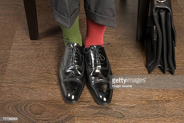 Man wearing odd socks